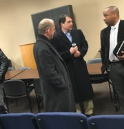 After Tuesday's sometimes-contentious Land Acquisition Committee meeting, Danny Grant, left, and Schools Director Millard House, right, with the Clarksville-Montgomery County School System, talk with County Commissioner Larry Rocconi.