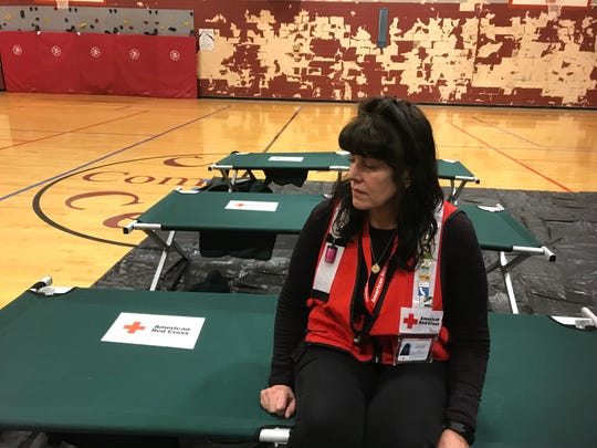 Marianne Gurney, a volunteer for the Red Cross Tennessee River Chapter sits on a cot at an emergency shelter she is managing at the Crow Community Center in Clarksville for people with no where else to go after their Ashford Place apartments were damaged by smoke or fire Tuesday, Jan. 29, 2019.