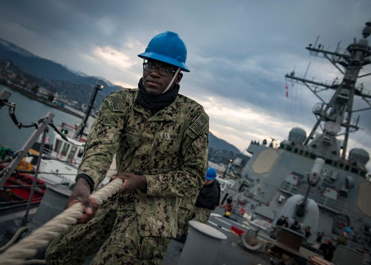 Seaman Recruit Doyon Staniger, from Somerset, heaves line as the Arleigh Burke-class guided-missile destroyer USS Donald Cook (DDG 75) departs Batumi, Georgia on Jan. 25, 2019. Donald Cook, forward-deployed to Rota, Spain, is on its eighth patrol in the U.S. 6th Fleet area of operations in support of U.S. national security interests in Europe and Africa.