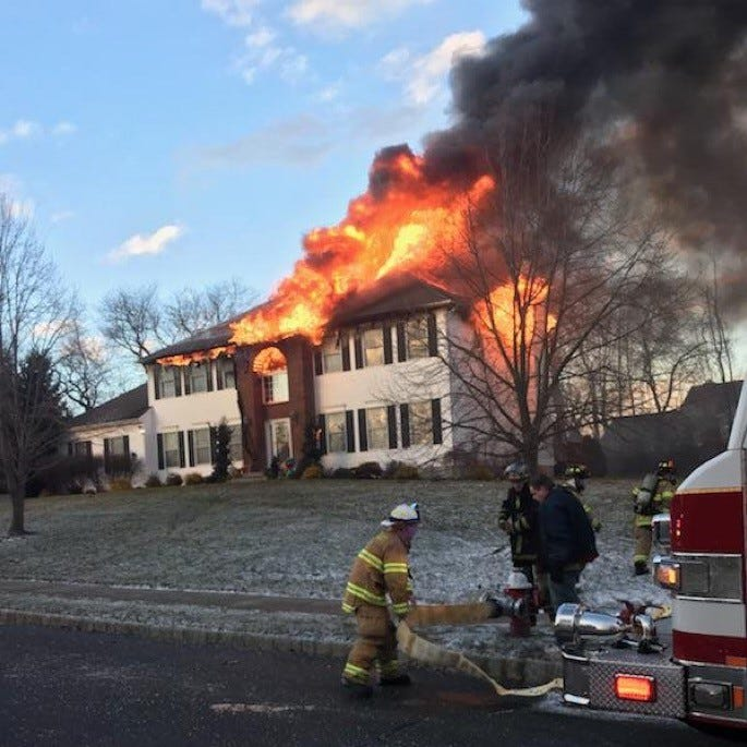 South Brunswick firefighters battle house fire