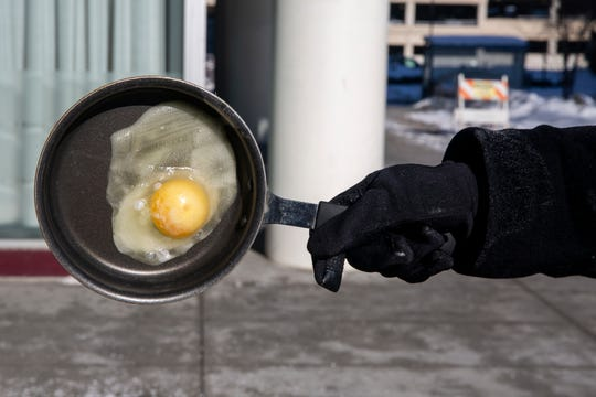 In just a few minutes an egg froze to this frying pan in the sub-zero temperatures on Wednesday, Jan. 30, 2019, in Des Moines.