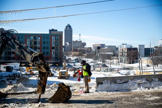 Des Moines Water Works crews fix a water main break in Des Moines' East Village on Wednesday, Jan. 30, 2019. The National Weather Service reported a new record low temperature of -19 in Des Moines on Wednesday morning.