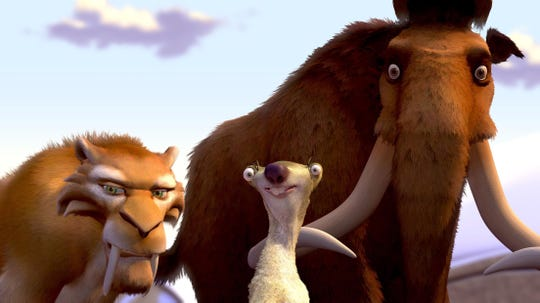 A woolly mammoth named Manny (Ray Romano, L), a sloth named Sid (John Leguizamo, C) and a saber-toothed tiger named Diego (Denis Leary, R) become unlikely heroes when they have to return a human child to its father while braving the deadly elements of the impending Ice Age.