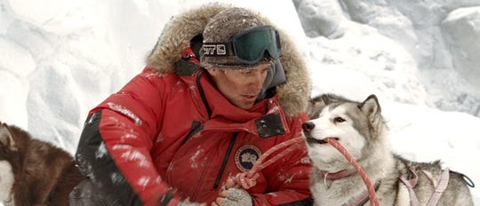 "Gerry Shepherd (Paul Walker) is forced  to leave his team of sled dogs behind,  as the team  fend for their survival, in ""Eight Below."""