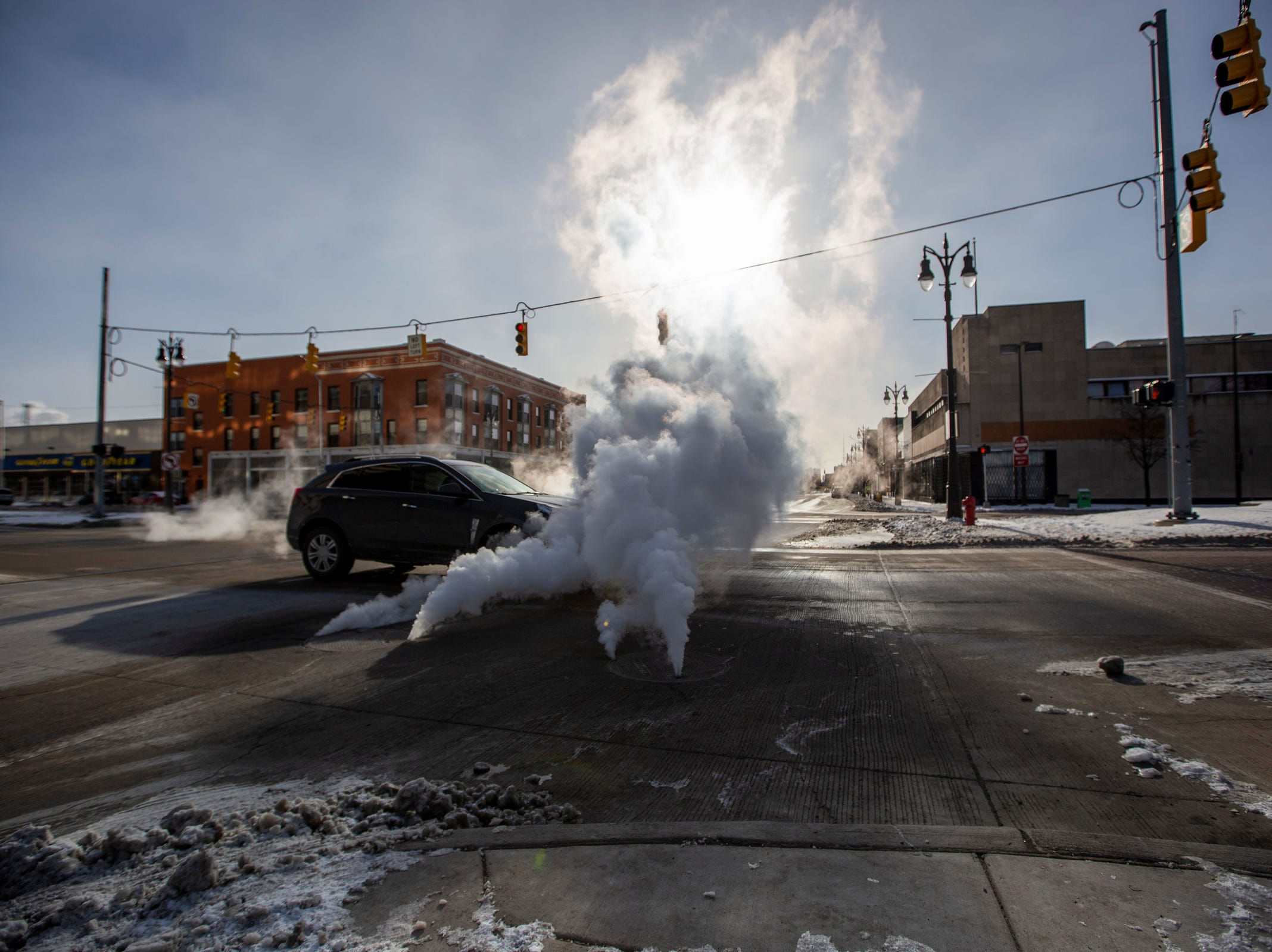 Steam bellows from a manhole cover on Woodward avenue  at West Grand boulevard in Detroit during subzero temperatures on Wednesday, Jan. 30, 2019.