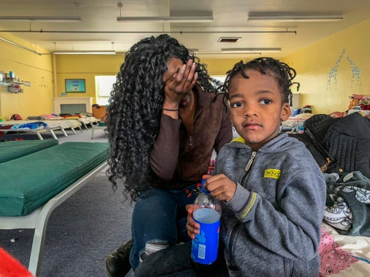 Amara Almore, 25, reflects on the difficult time she's been having being homeless at Genesis House III's warming center with her son Ayden, 5, in Detroit on Wednesday, Jan. 30, 2018. The shelter is run by Detroit Rescue Mission Ministries.