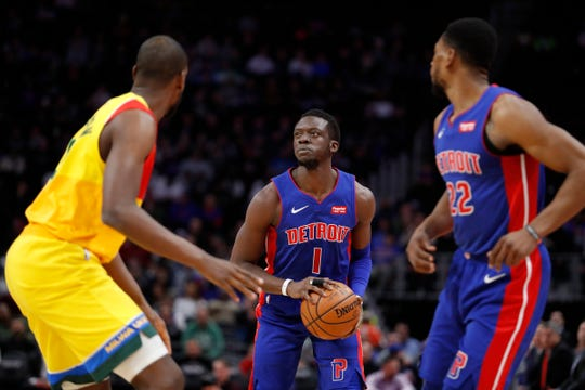 Detroit Pistons guard Reggie Jackson (1) prepares to shoot the ball during the first quarter against the Milwaukee Bucks at Little Caesars Arena on Tuesday, Jan. 29, 2019.