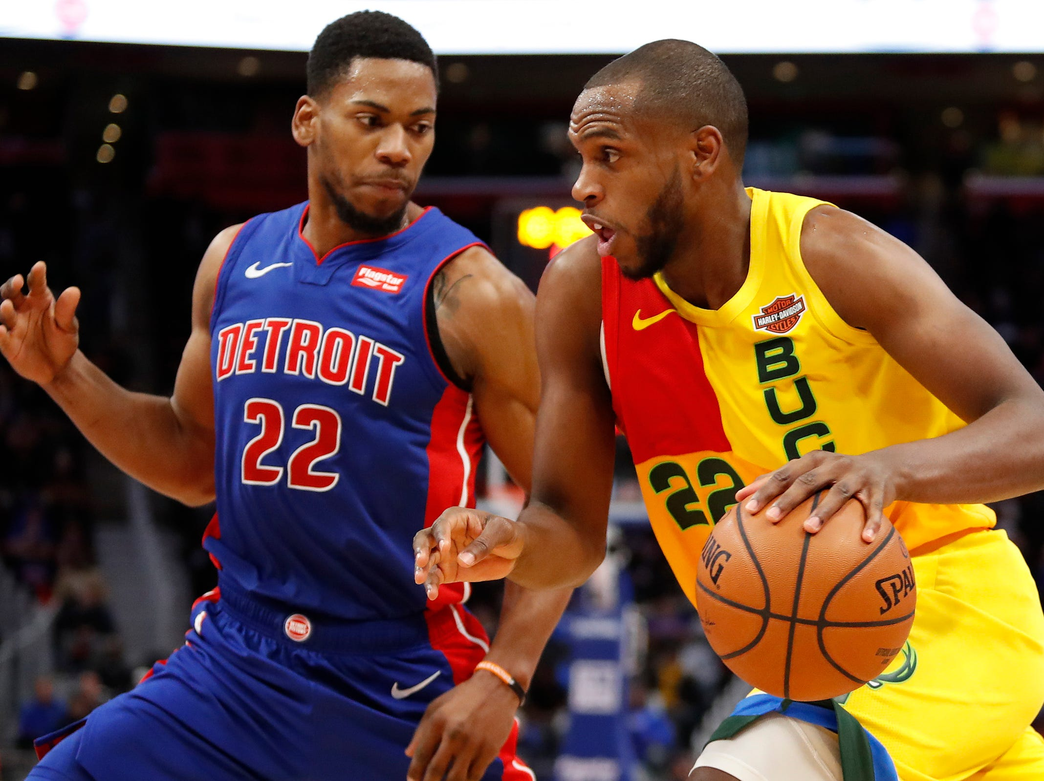 Bucks forward Khris Middleton dribbles the ball as Pistons guard Glenn Robinson III defends during the third quarter of the Pistons' 115-105 loss on Tuesday, Jan. 29, 2019, at Little Caesars Arena.
