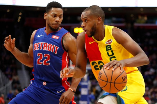 Bucks' Khris Middleton dribbles against the Pistons' Glenn Robinson III on Jan. 29 at Little Caesars Arena.