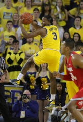 Michigan guard Zavier Simpson rebounds against Ohio State during the second half of the 65-49 win over Ohio State on Tuesday, Jan. 29, 2019, at Crisler Center.