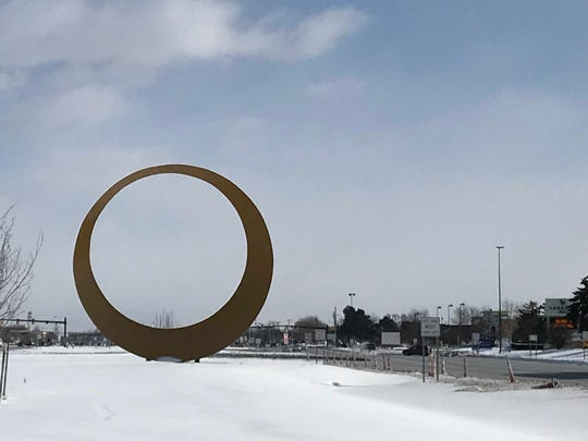 The M59 Golden Corridor icon in the median along M-59/Hall Road in Sterling Heights on Jan. 30, 2019.