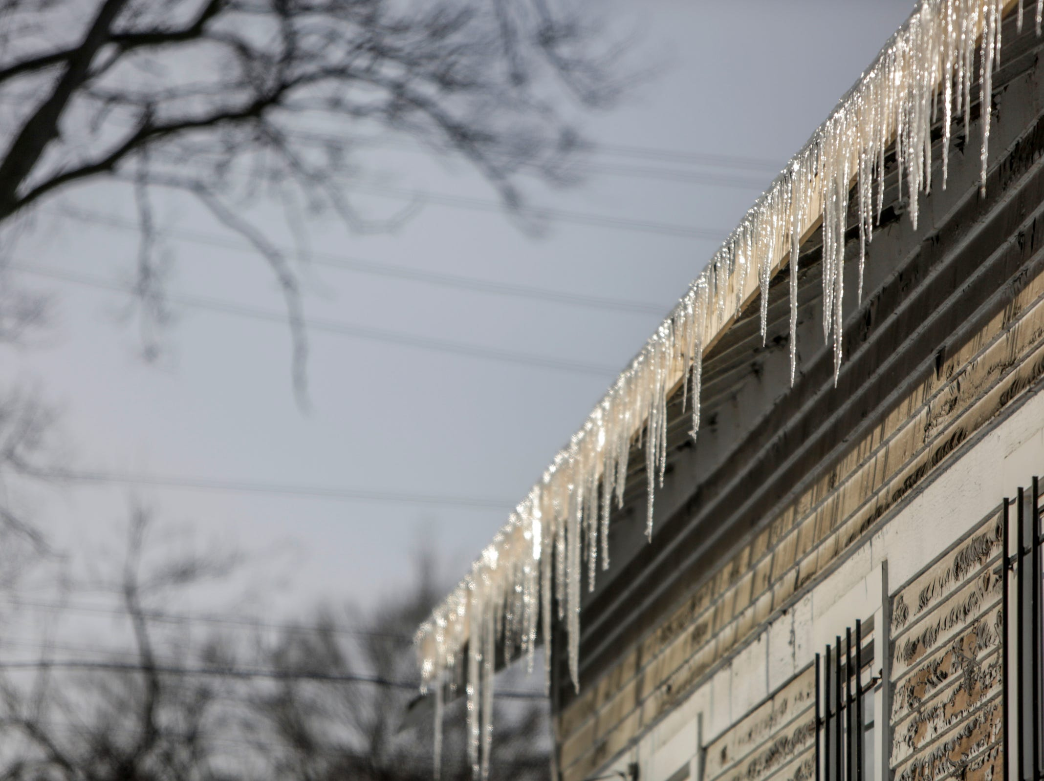 Icicles hang from a house in Detroit during subzero temperatures on Wednesday, Jan. 30, 2019.