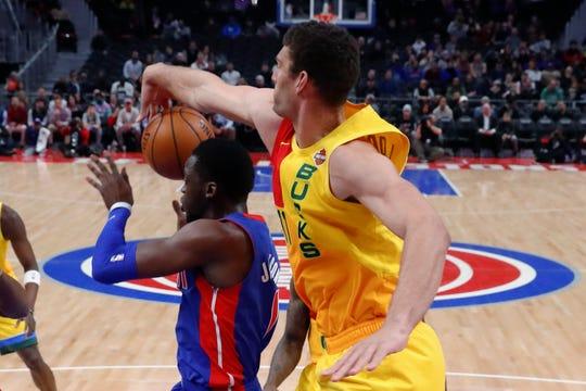 Milwaukee Bucks center Brook Lopez (11) blocks a shot by Detroit Pistons guard Reggie Jackson during the first half of an NBA basketball game in Detroit, Tuesday, Jan. 29, 2019.