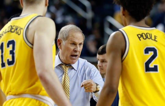 Michigan coach John Beilein talks to forward Ignas Brazdeikis (13) and guard Jordan Poole (2) during the second half of the team's NCAA college basketball game against Ohio State, Tuesday, Jan. 29, 2019, in Ann Arbor, Mich.