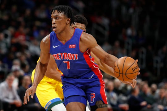 Detroit Pistons forward Stanley Johnson (7) dribbles the ball past Milwaukee Bucks forward Giannis Antetokounmpo (behind) during the second quarter at Little Caesars Arena on Tuesday, Jan. 29, 2019.
