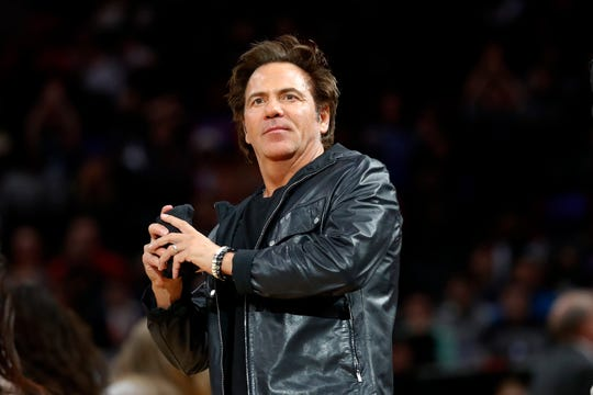 Tom Gores throws a shirt to fans Jan. 29 at LCA.