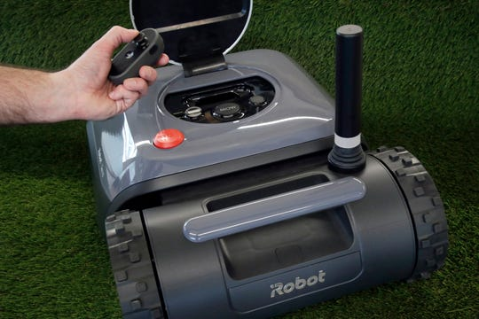 An iRobot Terra lawn mower with remote controller.