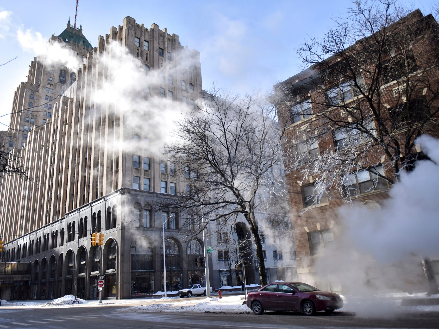 Wind gusts send steam through Detroit's New Center area Wednesday.