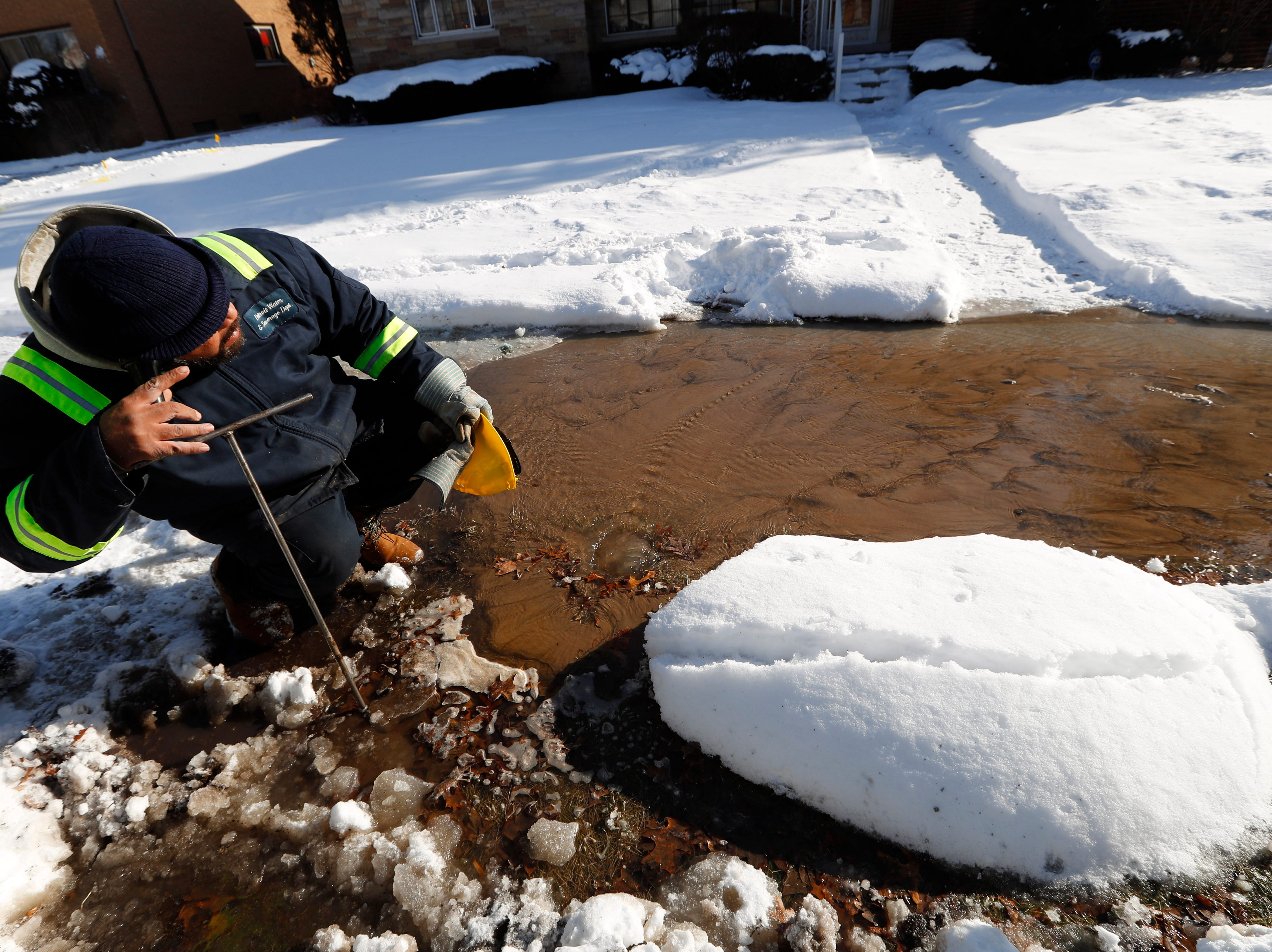 Chuck Bryant, a Detroit Water and Sewerage worker, uses an aqua phone to locate a water main break in Detroit, Wednesday.