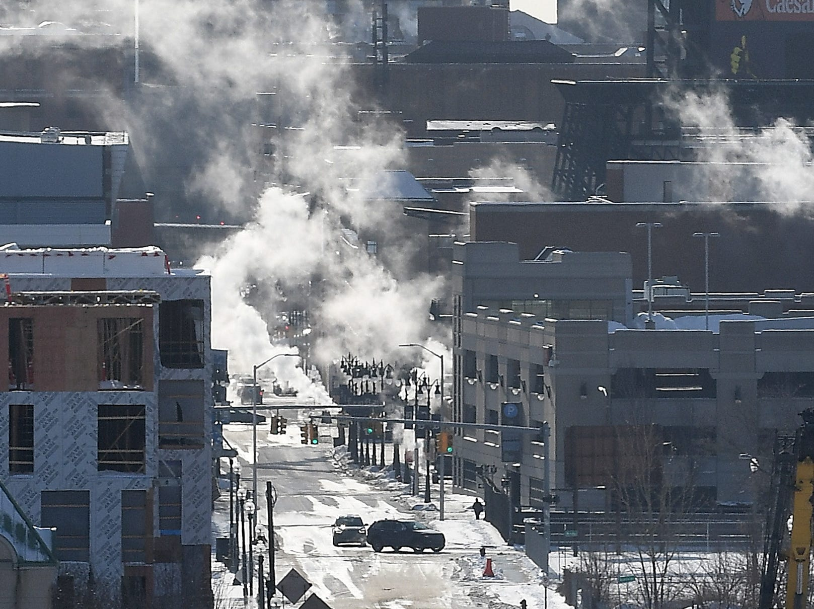 Steam rises over Brush Street in downtown Detroit Wednesday.