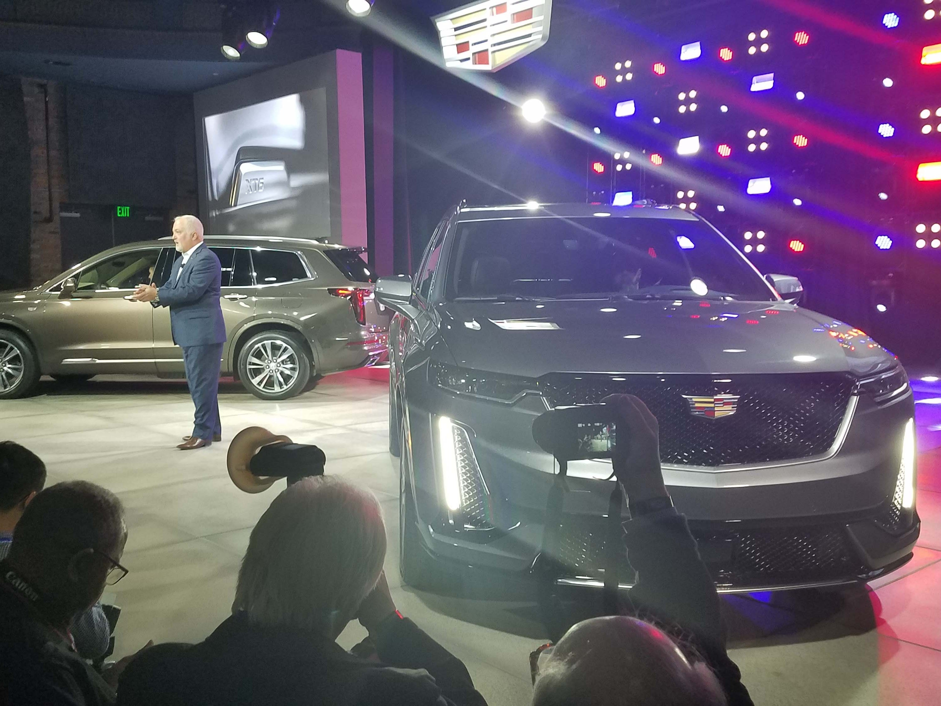 Cadillac chief Steve Carlisle opens Detroit Auto Show week by unveiling the all-new, three-row XT6 SUV. Cadillac has struggled to match German rivals' sales pace in luxury SUVs.