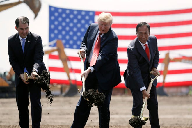 """Former Wisconsin Gov. Scott Walker, left, and President Donald Trump last summer touted Foxconn Technology Group's $10 billion investment in the southeast corner of the state -- a play that is turning out to be focused far more on employing """"knowledge workers"""" and less on the blue-collar jobs promised by Foxconn CEO Terry Gou, right."""