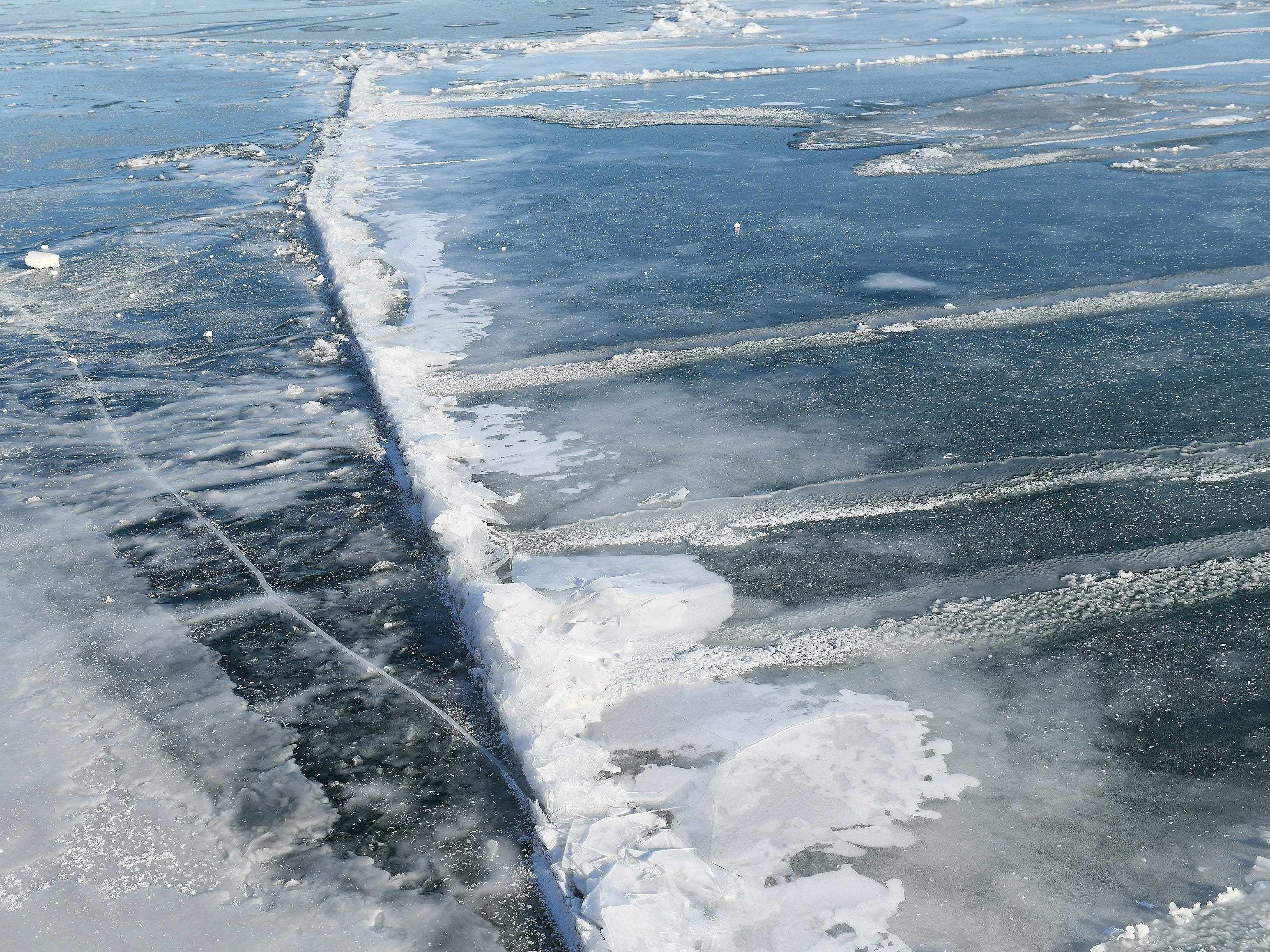 A pressure ridge forms on the icy Detroit River where floes collided.