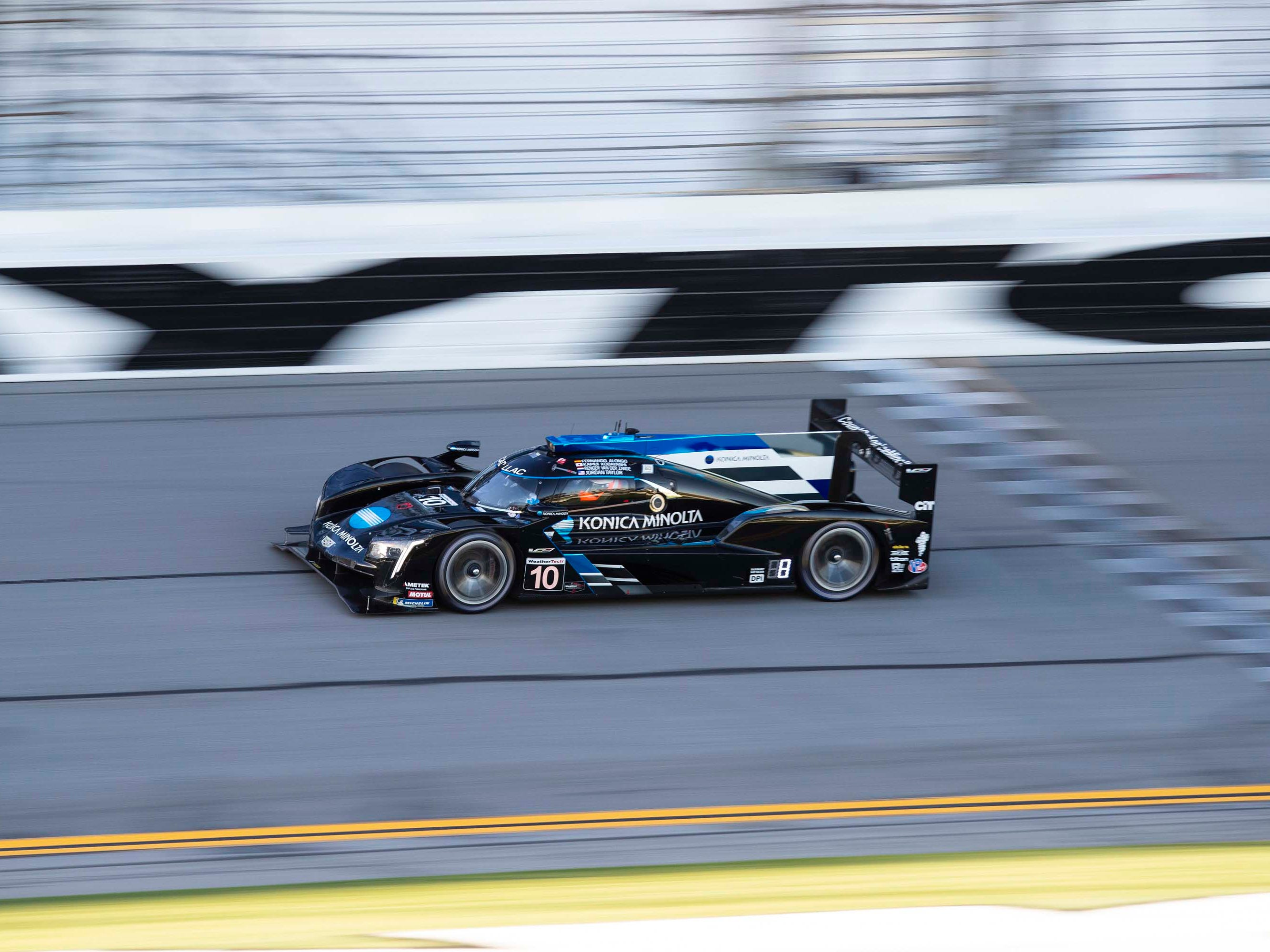 The Cadillac DPi-V.R makes 600 horsepower from its ground-pounding, 6.2-liter V-8 engine. Here it flashes by on the Daytona Speedway straight at the Rolex 24 Hours.