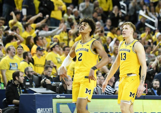 Michigan guard Jordan Poole reacts coming off the court at a timeout after multiple technical fouls are called on  both teams in the second half.