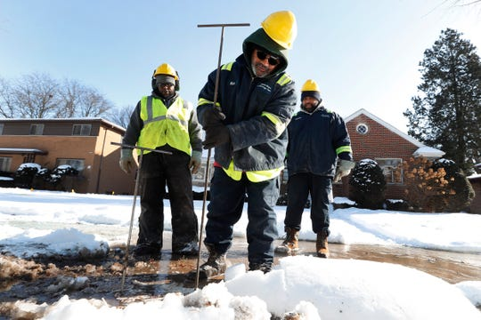 Richard James, a Detroit Water and Sewerage worker, uses a poking rod to find a water main break in Detroit. A break Monday in Ferndale caused the water to appear cloudy or dingy for some residents.