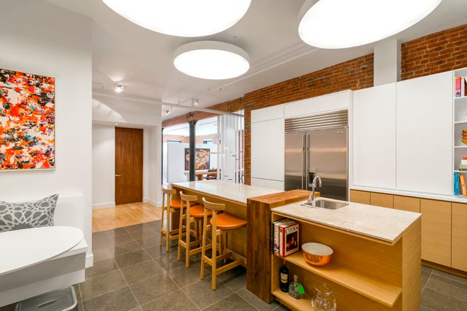 This photo provided by Michael Wood Interiors shows a kitchen project by interior designer Michael Wood in New York's West Village, in which he used butcher block, soapstone and Corian on the island. Mixed materials are a popular trend for today's kitchen islands. (Allyson Lubow/Michael Wood Interiors via AP)