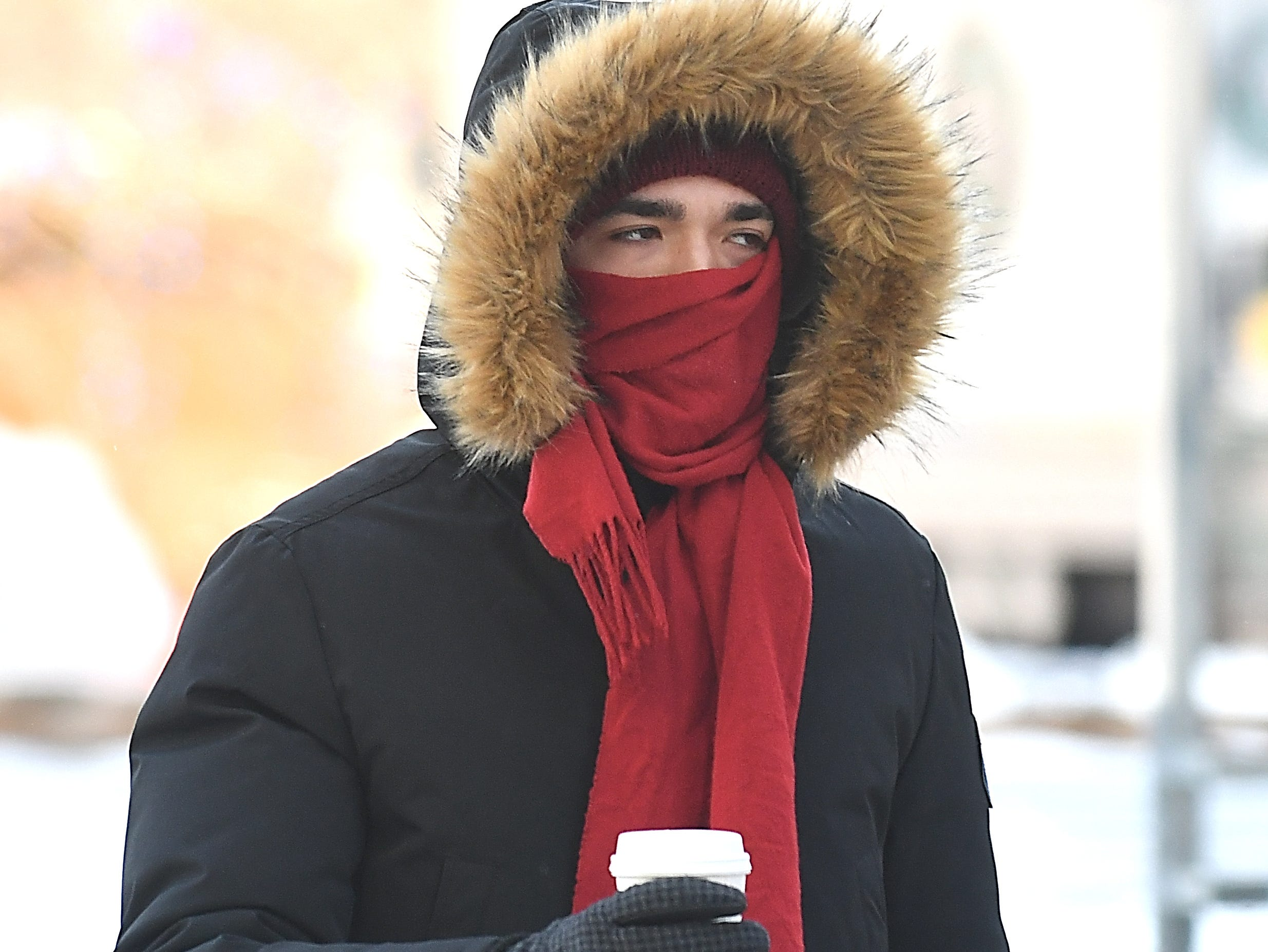 Timothy Smith braves the cold for a cup of coffee on Wednesday in Detroit.