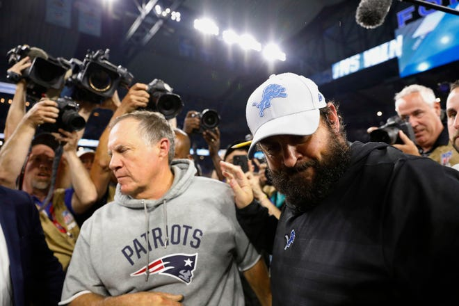New England Patriots coach Bill Belichick, left, and Detroit Lions coach Matt Patricia meet after the Lions' 26-10 victory in September at Ford Field.
