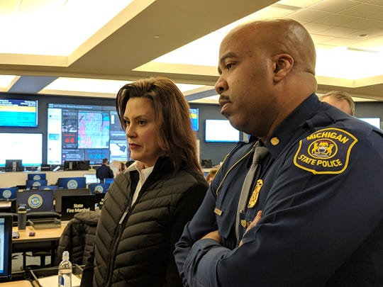 Michigan Gov. Whitmer and Michigan State Police Capt. Emmitt McGowan at the state Emergency Operations Center on Jan. 30, 2019.