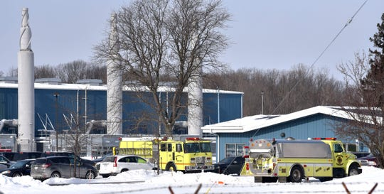 Washington Township Engine 3, left, and Armada Township Water One stand by at the facility after the explosion and fire.