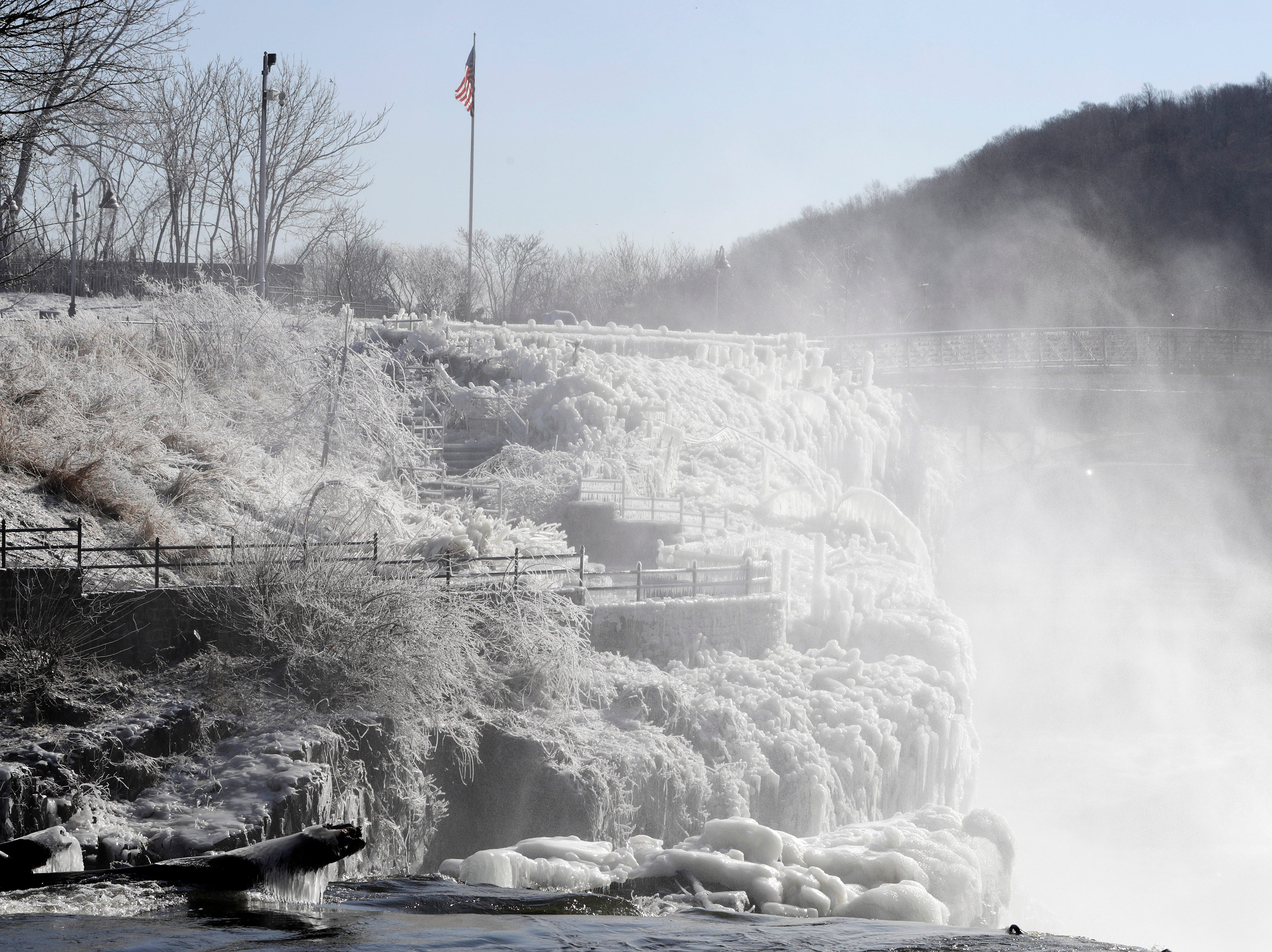 Ice covers the observation area at the Great Falls National Historic Park during a frigid cold winter day, Wednesday, Jan. 30, 2019, in Paterson, N.J. A snowstorm and snow squalls are expected in the afternoon before temperatures continue to dip to evermore frigid lows.