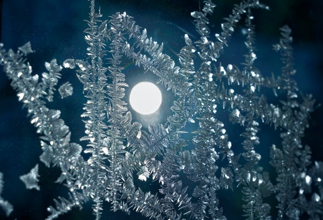 The sun is seen through ice formed on a window in Burnsville, Minn., Wednesday, Jan. 30, 2019, as a deadly arctic deep freeze envelopes the Midwest with record-breaking temperatures.