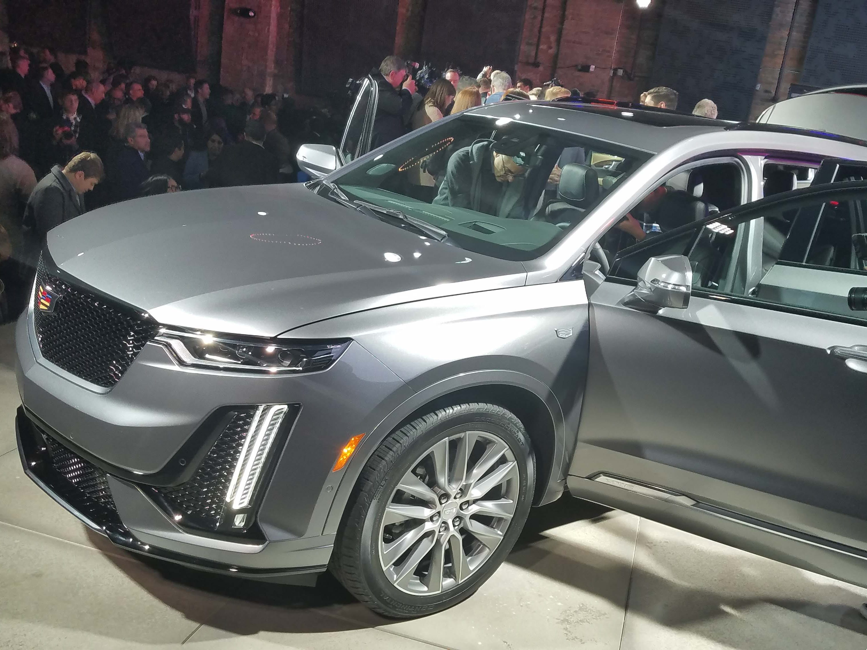 Media mob the Cadillac XT6 at the Detroit Auto Show. The three-row XT6 is the fourth Cadillac SUV entry following the XT4, XT5 and Escalade. The brand has been playing catch-up in the luxury SUV market.