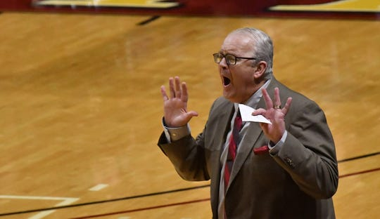 """Kevin Vande Streek, who is in his 23rd season as Calvin's men's basketball coach, admits he had """"no idea"""" the magnitude of the rivalry with Hope when he interviewed for the position."""