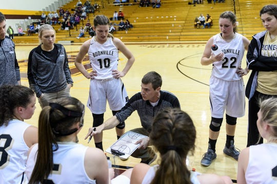Boonville girls' basketball coach Jason Gansman talks to his team during the 3A Sectional 32 first-round game this past January. The Pioneers lost to Mount Vernon, 57-49.