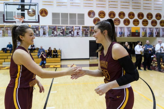 Gibson Southern's Claire Jones (15) and Gibson Southern's Tabby Klem (20) perform a special handshake as their team is introduced before their game against the Bosse Bulldogs in the Class 3A Sectional 32 at Gibson Southern High School in Fort Branch, Ind., Tuesday, Jan. 29, 2019. The Lady Titans defeated the Bulldogs, 86-26.