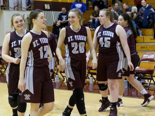 The Mount Vernon Wildcats celebrate their 57-49 win over the Boonville Pioneers in the first round of the IHSAA Class 3A Sectional 32 at Gibson Southern High School in Fort Branch, Ind., Tuesday, Jan. 29, 2019.
