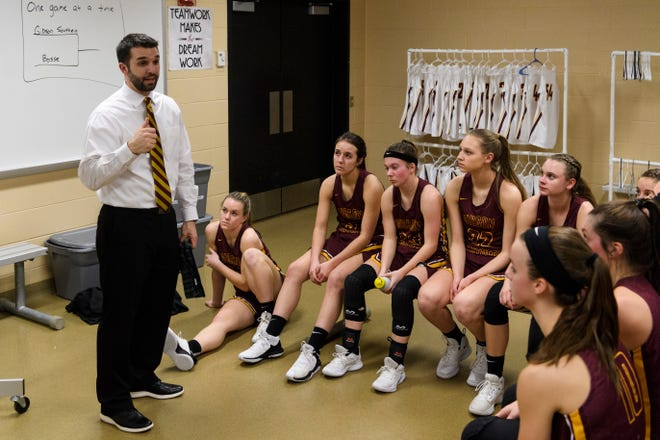Gibson Southern Head Coach Kyle Brasher talks to his team during halftime against the Bosse Bulldogs during the first round of the Class 3A Sectional 32 at Gibson Southern High School in Fort Branch, Ind., Tuesday, Jan. 29, 2019. The Lady Titans defeated the Bulldogs, 86-26.