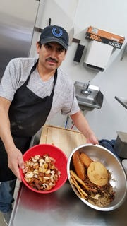 Alfonzo Hernandez with a few of the ingredients for a traditional Oaxacan molé at Lucy's Traditional Tex-Mex Restaurant.