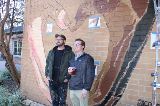 Muralist Cosby Hayes (left) and NAI TALCOR Advisor Slaton Murray (right) standing in front of their latest collaboration with KCCI.