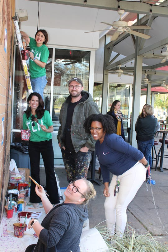 2018 KCCI Community Catalyst Elizabeth Emmanuel (ladder), KCCI Executive Director Betsy Couch (back left), muralist Cosby Hayes (back right) and 2019 KCCI Community Catalysts Chelsea Workman (front left) and Dara Wilson (front right) painting the mural in Manor @ Midtown.