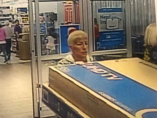 Cape Coral police report that this woman is a suspect after a crash victim reported her credit cards were stolen from her purse, left at the crash site.