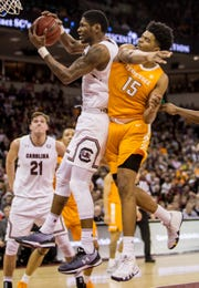 South Carolina Gamecocks forward Chris Silva (30) grabs a rebound over Tennessee Volunteers forward Derrick Walker (15) in the first half at Colonial Life Arena Tuesday night in Columbia.