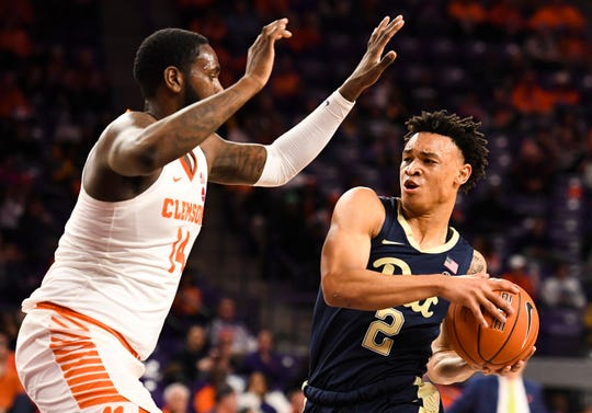 PittsburghÕs Trey McGowens (2) attempts to throw the ball past Clemson forward Elijah Thomas (14) at Littlejohn Stadium on Tuesday, Jan. 29, 2019.