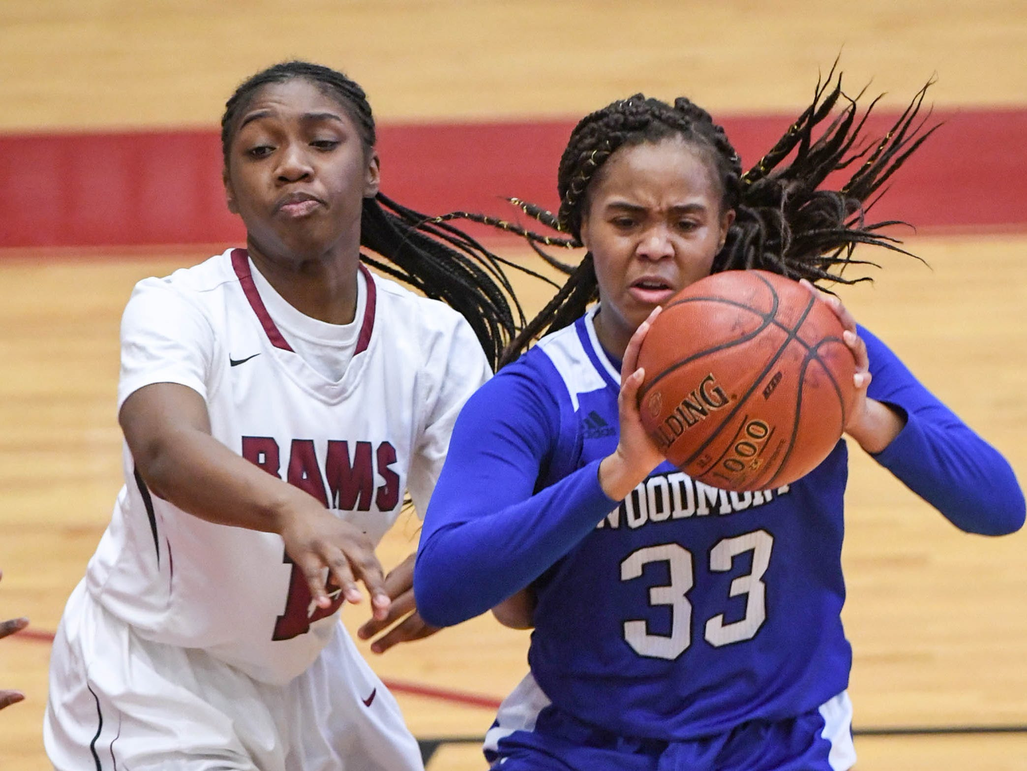 Westside senior Tanazza Wardlaw(15) pressures Woodmont senior Kitara Henry(33) during the third quarter at Westside High School in Anderson on Tuesday.
